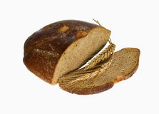 Bread and ear. Rye bread with ears of wheat on a white background photographed in natural light Royalty Free Stock Images