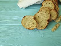Bread ear organic towel on fresh a blue wooden sliced lunch nutrition bake textile health. Bread ear of  towel on a blue wooden homemade textile health bake Royalty Free Stock Image