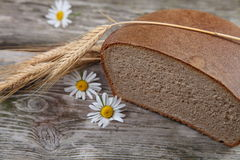 Bread ears and daisies Stock Photo