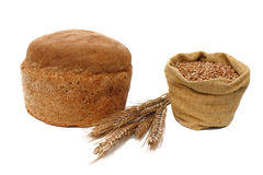 Bread, ears and grain in a bag isolated on a white Stock Photos
