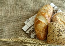 Bread and ears on sacking. Royalty Free Stock Photos