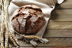 Bread with ears of wheat on a background boards Royalty Free Stock Images