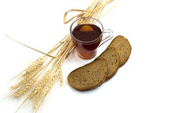 Bread and ears of wheat, glass of tea Royalty Free Stock Photo