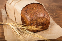 Bread with ears of wheat Royalty Free Stock Photography