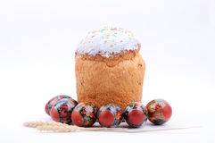 Bread with Easter eggs. Easter bread and eggs on a white background Stock Photo