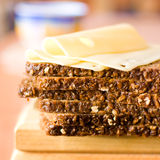 Bread and Edam cheese. Wholemeal bread with Edam cheese set on trencher royalty free stock photos