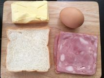 Bread egg butter and ham. For breakfast Royalty Free Stock Photo