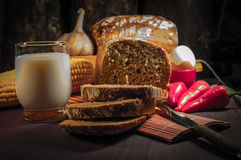 Bread, egg, milk and vegetables. Breakfast. The composition of the food products on the table Royalty Free Stock Images