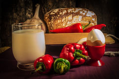 Bread, egg, milk and vegetables. Breakfast. The composition of the food products on the table Stock Image