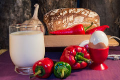 Bread, egg, milk and vegetables. Breakfast. The composition of the food products on the table Royalty Free Stock Photo