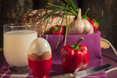 Bread, egg, milk and vegetables. Breakfast. The composition of the food products on the table Royalty Free Stock Photography