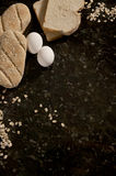 Bread, egg, oat and cereals over a stone cover. Bread, egg an cereals over a stone surface Royalty Free Stock Image
