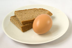 The bread and egg on plate Royalty Free Stock Photos