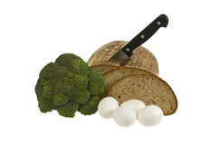 Bread, eggs and broccoli. Loaf of bread with knife, eggs and broccoli isolated over white background Royalty Free Stock Photo