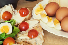 Bread with eggs, cherry tomatoes and green lettuce Royalty Free Stock Images