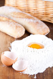 Bread, eggs and flour Stock Photography