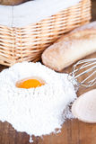 Bread, eggs, whisk and flour Stock Images