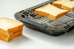 Bread in electric grill stock photo