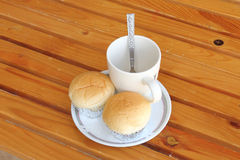 Bread with empty cup of coffee Stock Images