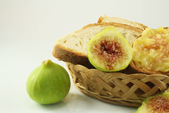 Bread and figs. Still life with homemade bread and white figs Royalty Free Stock Photos