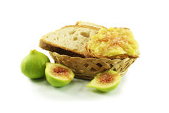 Bread and figs. Still life with homemade bread and white figs Stock Photos
