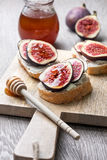 Bread with figs, ricotta Stock Photos