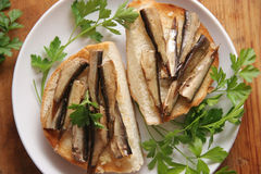 Bread and fish. Fried bread with sprats and garlic Royalty Free Stock Photo