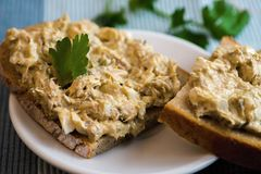 Bread with fish spread. stock images
