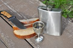 Bread flask and knife Stock Images