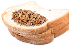 Bread and flex seeds Royalty Free Stock Images