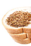 Bread and flex seeds Royalty Free Stock Photography