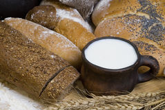 Bread, flour, cereals and a cup of milk. Stock Images