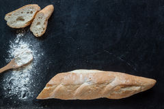 Bread and flour on chalkboard  for bakery background Stock Images