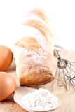 Bread, flour, eggs and kitchen utensil Royalty Free Stock Photography