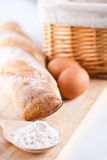 Bread, flour, eggs and kitchen utensil Stock Photos