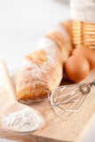 Bread, flour, eggs and kitchen utensil Royalty Free Stock Images