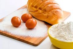 Bread, flour and eggs Royalty Free Stock Photos
