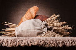 Bread, flour sack and ears bunch still life Royalty Free Stock Photos