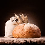 Bread, flour sack and ears bunch still life Stock Image