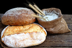 Bread and flour in a sack Royalty Free Stock Photos