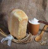 Bread and flour on sacking background Stock Photography