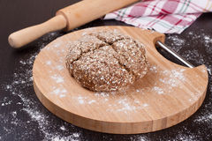 Bread on a floured board Royalty Free Stock Photography