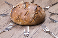 Bread and fork Stock Images