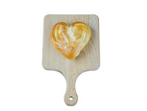 Bread in the form of heart on oak isolated on white background Stock Photo