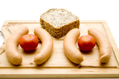 Bread with frankfurter and tomatoes Stock Photos
