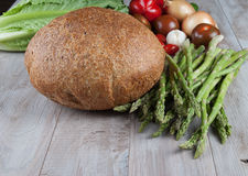 Bread and Fresh Asparagus with vegetables. On Wooden Background Royalty Free Stock Photos