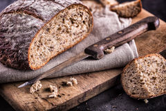 Bread. Fresh bread. Homemade traditional bread. Sliced bread crumbs knife and cumin Royalty Free Stock Photos