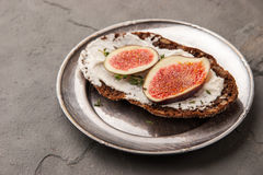 Bread with fresh cheese  , fig and thyme on the vintage metal plate Royalty Free Stock Images