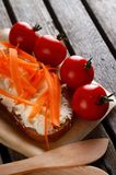 Bread with fresh cheese on rustic table Royalty Free Stock Photography