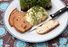 Bread with fresh cheese. Some bread with fresh cheese and green cress Royalty Free Stock Images
